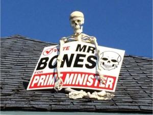 Mr. Bones shows off this election sign.  Photo Credit: Blair Crawford, Ottawa Citizen